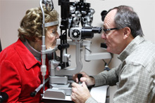 Dr. Greg examining a senior