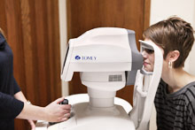 woman receiving eye exam