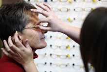 a senior trying on glasses in optical shop