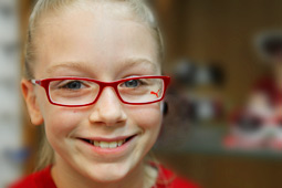 young girl wearing red glasses