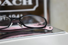 pair of Coach glasses on display